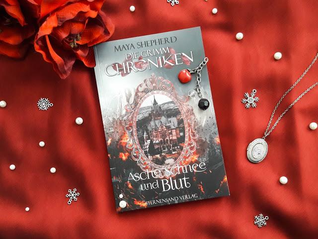 Die Grimm-Chroniken: Asche, Schnee und Blut – Maya Shepherd graphic
